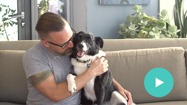 Image of man with his dog. Click to launch the video.