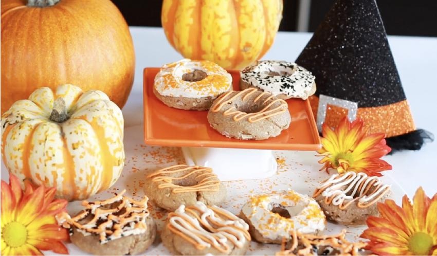 Cinnamon donuts surrounded by pumpkins