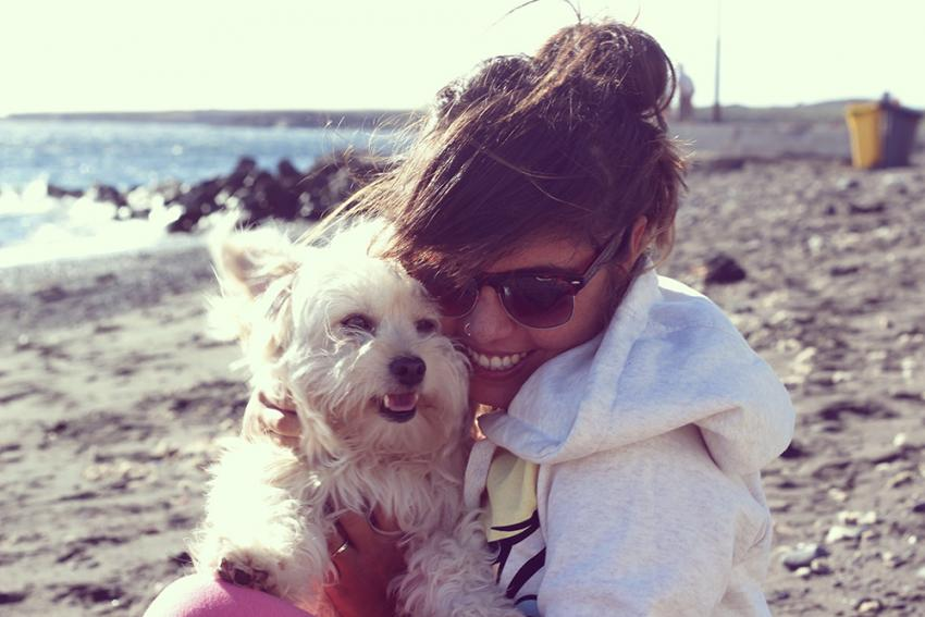 happy memory of woman and dog on the beach