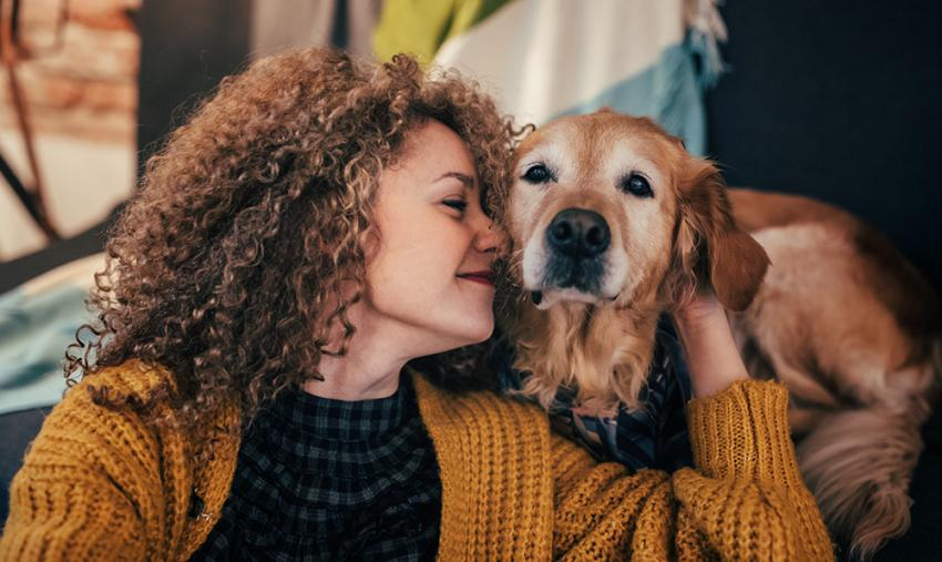 Woman nuzzling with a dog