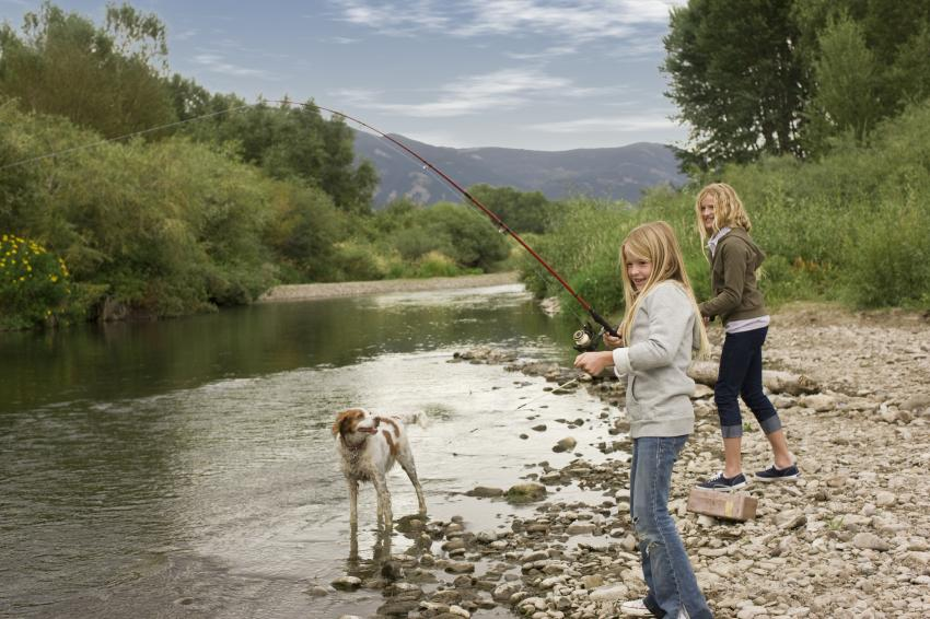 Kids fishing with dog