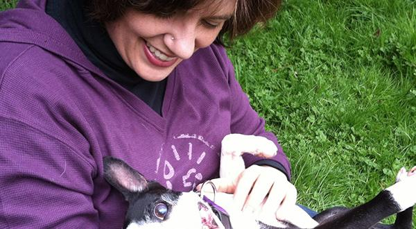 Woman in purple hoodie with a dog